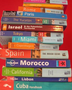 high stack of old guide books to european countries